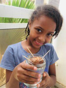 Oak Meadow student with potato hair science project - homeschool